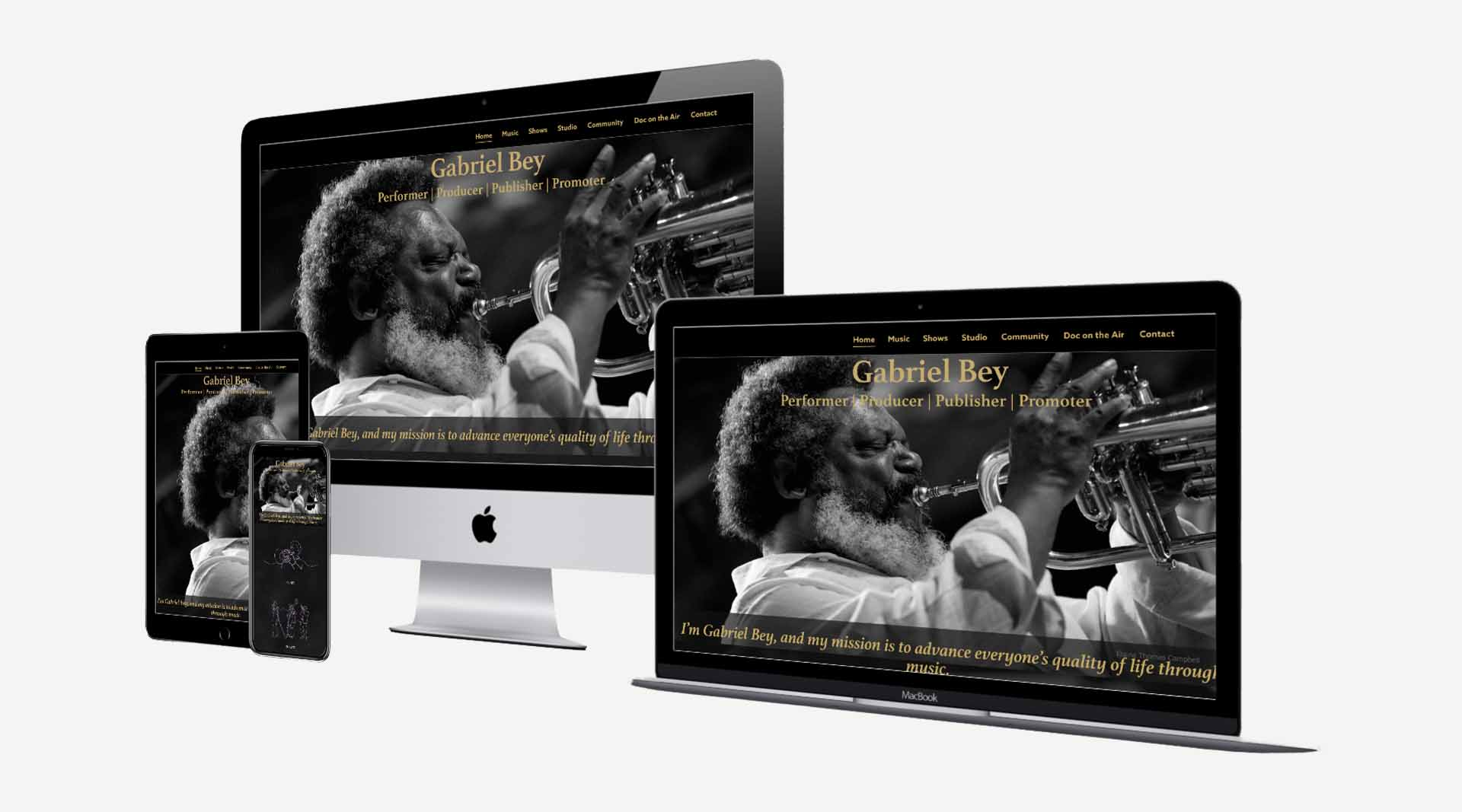 Graphic showing the website designed by Clamshell Communications for Gabriel Bey on four device screens